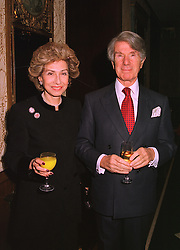 LORD & LADY FELDMAN at a party in London on 13th November 1998.<br /> MLY 9