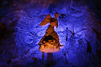 An illuminated sculpture of an angel deep in the Salt Cathedral of Zipaquira, Colombia, South America