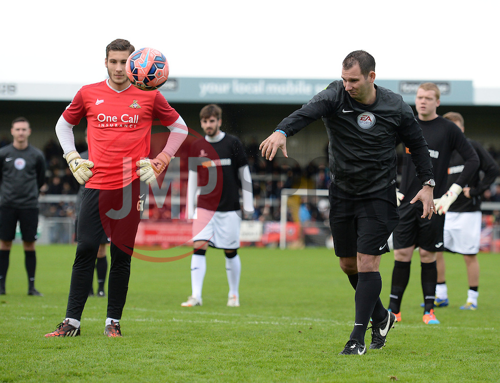 Referee Tim Robinson throws a ball into the box to check the state on the pitch. - Photo mandatory by-line: Alex James/JMP - Mobile: 07966 386802 - 08/11/2014 - SPORT - Football - Weston-super-Mare - Woodspring Stadium - Weston-super-Mare v Doncaster - FA Cup - Round One