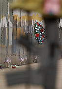 """A memorial wreath stands in front of the Traveling Vietnam Veterans Memorial, the """"Traveling Wall"""",  during its visit to Petoskey, Michigan."""