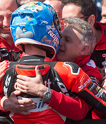 February 25, 2018 - Melbourne, Victoria, Australia - Italian rider Marco Melandri (#33) of Aruba.it Racing - Ducati is congratulated by team mates after winning the second race on day 3 of the opening round of the 2018 World Superbike season at the Phillip Island circuit in Phillip Island, Australia. (Credit Image: © Theo Karanikos via ZUMA Wire)