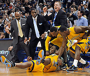 Marquette's Jae Crowder, bottom and his team reacts after he is fouled while making a basket in the second half of an NCAA college basketball game against Connecticut in Hartford, Conn., Saturday, Feb. 18, 2012.  Crowder was top-scorer for Marquette with 29 points in their 79-64 win. (AP Photo/Jessica Hill)