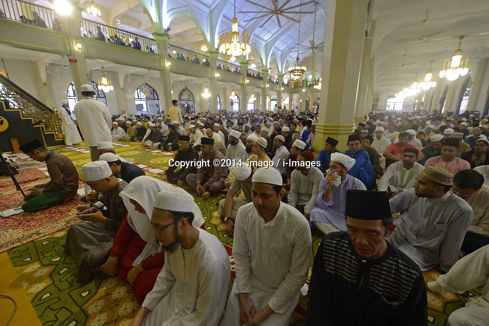 Image ©Licensed to i-Images Picture Agency. 28/07/2014. Singapore.<br /> 61981778<br /> Muslims attend morning prayers held at Sultan Mosque in Singapore on July 28, 2014. Muslims in Singapore on Monday celebrated Eid al-Fitr, marking the end of Ramadan, and attend morning prayers at the mosque. Picture by  imago / i-Images<br /> UK ONLY