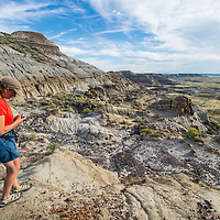 fort peck lake dry arm woman looking at fossil in badlands painted hills