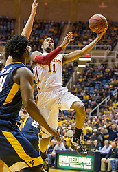 Feb 22, 2016; Morgantown, WV, USA; Iowa State Cyclones guard Monte Morris (11) shoots in the lane during the first half against the West Virginia Mountaineers at the WVU Coliseum. Mandatory Credit: Ben Queen-USA TODAY Sports
