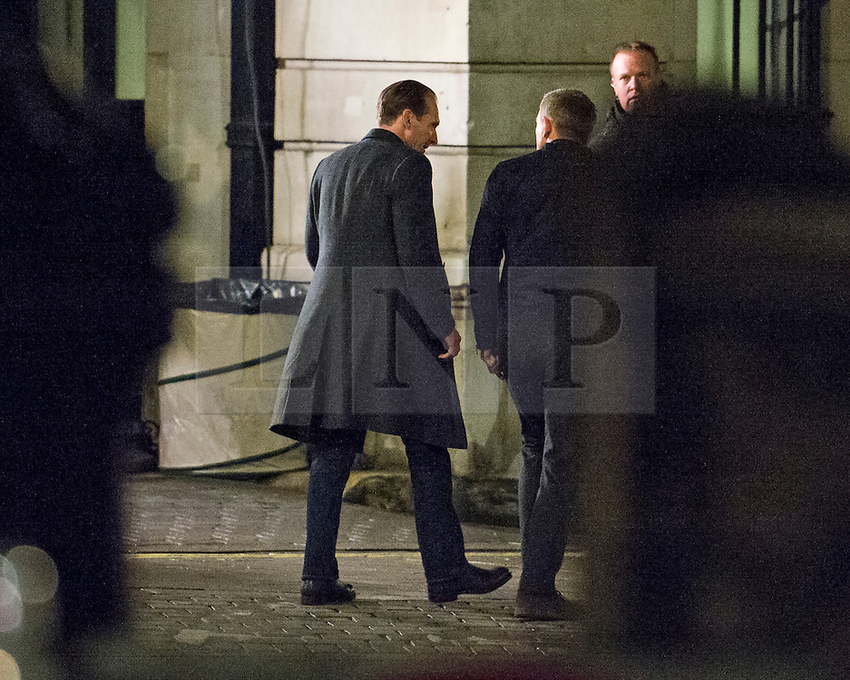 """© Licensed to London News Pictures. 31/05/2015. London, UK. . Ralph Fiennes (left) and Danel Craig (Right) Filming for the new James Bond film """"Spector"""" around Trafalgar Square in Westminster, London . Photo credit: Ben Cawthra/LNP"""