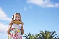 Portrait of girl (5-6) eating corn on the cob