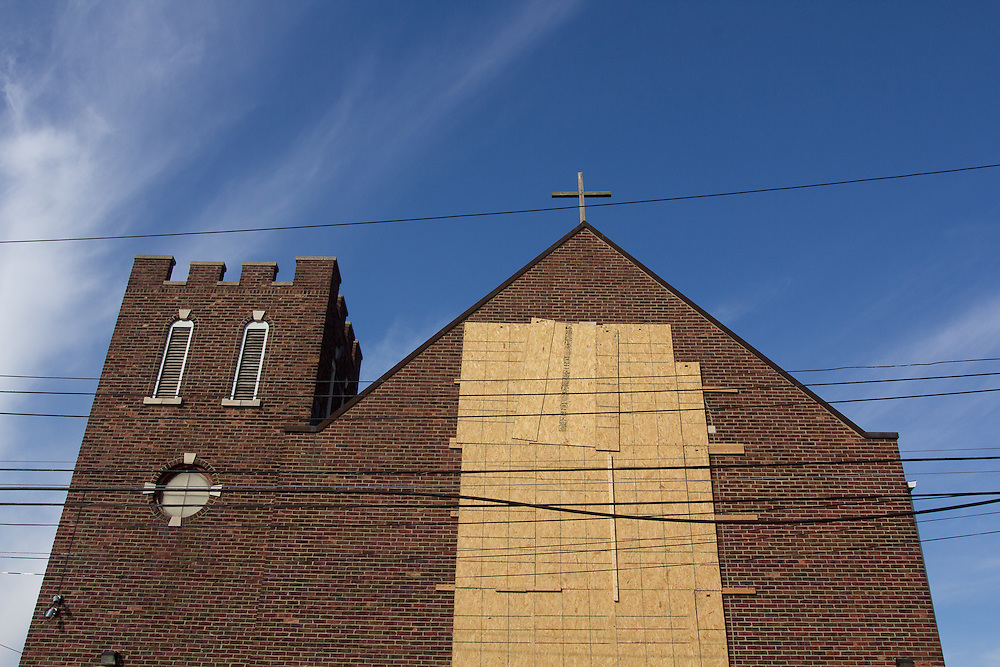 The stained-glass windows of St. George Malankara Orthodox Church of India on Cedar Grove Avenue face New Dorp Beach and were broken by high winds and debris during Hurricane Sandy .