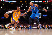 02 April 2013: Guard (24) Kobe Bryant of the Los Angeles Lakers drives to the basket while being guarded by (0) Shawn Marion of the Dallas Mavericks during the second half of the Lakers 101-81 victory over the Mavericks at the STAPLES Center in Los Angeles, CA.