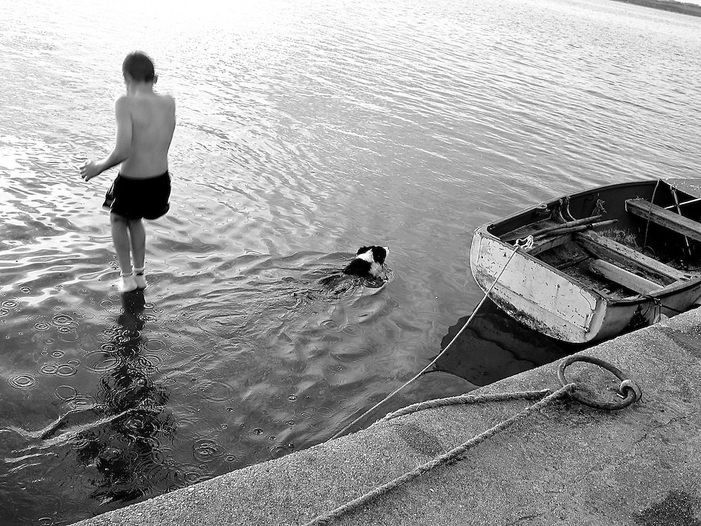 A boy and a dog swimming at Carne, Co. Wexford, Ireland, August 2004.