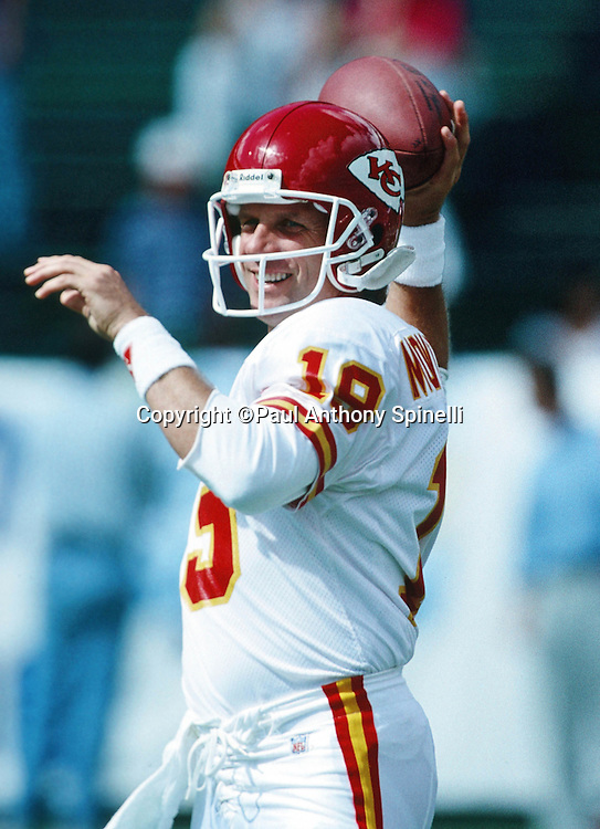 Kansas City Chiefs quarterback Joe Montana (16) smiles as he throws a pass while warming up before the NFL football game against the San Diego Chargers on Oct. 17, 1993 in San Diego. The Chiefs won the game 17-14. (©Paul Anthony Spinelli)