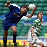 Celtic v St Johnstone..  23.02.03<br />Ian Maxwell beats David Fernadez<br /><br />Pic by Graeme Hart<br />Copyright Perthshire Picture Agency<br />Tel: 01738 623350 / 07990 594431