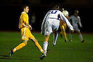 9 NOV. 2010 -- ST. LOUIS -- St. Louis University High School soccer player Tommy Behr (20, right) advances the ball past Christian Brothers College High School's Dylan Hundelt (11) during the first half of the MSHSAA Class 3 Sectionals at SLUH Tuesday, Nov. 9, 2010. The Jr. Bills won, 2-1, on a pair of first half goals by Ryan Merrifield. SLUH will take on Jackson High School Saturday, Nov. 13 at Jackson. Image © copyright 2010 Sid Hastings.