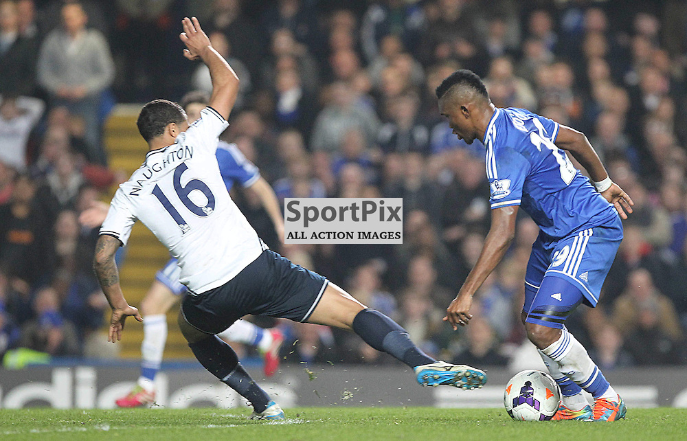 Chelsea's Samuel Eto'o takes the ball past Tottenham's Kyle Naughton during the English Barclays Premiership match between Chelsea FC and Tottenham Hotspur FC at Stamford Bridge, London, 8th March 2014 © Phil Duncan | SportPix.org.uk