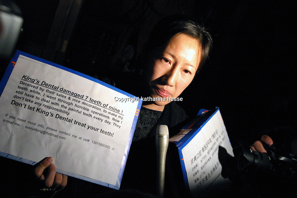 "BEIJING, 18 DECEMBER 2004: a protester demonstrates at  the ""first worldwide artificial beauty pageant ""  in a theatre in Beijing, 18 December , 2003, in China...Beauty business in China , from cosmetic surgeries to hair brush sales, has amounted to more than USD 7 billion in 2003. The contest for women who have undetgone plastic surgery was organized after Yang Yuan, a young would-be model, was disqualified earlier on this year when organizers discovered that she'd had plastic surgery. Yang was present during the contest to introduce her biography that explains why she has the right to ""improve"" her natural features..."