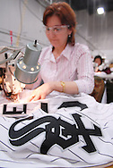 4/3/09 10:47:21 AM -- Easton, PA, U.S.A. -- Djoumile Pendeva, a seamstress at Majestic Athletic sews lettering on the back of a Chicago White Sox jersey April 3, 2009 in Easton, Pennsylvania. White Sox jerseys and gear have experienced a boost in sales with Obama, a White Sox fan, in the White House. -- .Photo by William Thomas Cain,  cainimages.com.