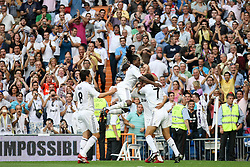 Real Madrid's players celebrate goal during La Liga match.September 2 2009.