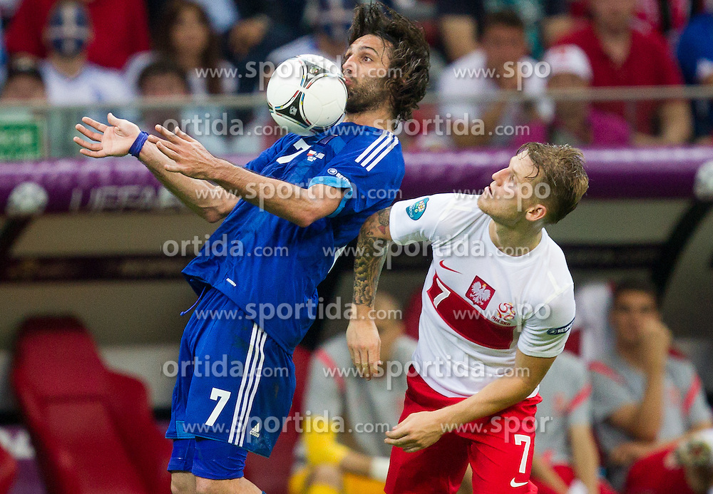 Giorgos Samaras  of Greece vs Artur Sobiech of Poland during the UEFA EURO 2012 group A match between Poland and Greece at The National Stadium on June 8, 2012 in Warsaw, Poland.  (Photo by Vid Ponikvar / Sportida.com)