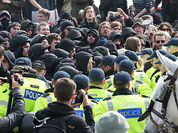 © Licensed to London News Pictures . 02/04/2016 . Dover , UK . Anti-fascist protesters block the far-right march route . Demonstrations by far-right groups (including The National Front , The North West Infidels and The South East Alliance ) and , opposing them , anti-fascists , close to the port of Dover in Kent . Photo credit : Joel Goodman/LNP