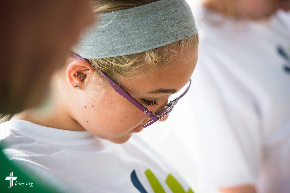 Y4Life student volunteer Morgan Sims joins other high and middle school student volunteers in prayer outside a Planned Parenthood in Orlando, Fla., during a Y4Life servant event on Saturday, Sept. 12, 2015.  LCMS Communications/Erik M. Lunsford
