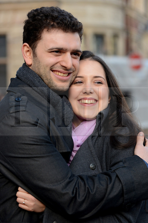 © Licensed to London News Pictures. 23/02/14 A couple who won a supreme court challenge are to marry in the Church of Scientology Chapel in London today 23rd February 2014. FILE PICTURE DATED 11/12/2013. London, UK.Louisa Hodkin and her fiance, Alessandro Calcioli pose for a photograph after they left The Supreme Court in London. Louisa Hodkin, a member of the Church of Scientology wants to marry in a Church of Scientology chapel has won her Supreme Court challenge today.Photo credit : Peter Kollanyi/LNP