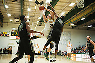 Vermont's Drew Urquhart (25) leaps over Dartmouth's Miles Wright (22) for a lay up during the men's basketball game between the Dartmouth Big Green and the Vermont Catamounts at Patrick Gym on Wednesday December 7, 2016 in Burlington (BRIAN JENKINS/for the FREE PRESS)