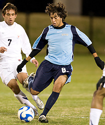 St. Peters midfielder Victor Prada (8) passes the ball.  The Virginia Cavaliers defeated the Saint Peters Peacocks 3-1 in the first round of the NCAA Men's Soccer tournament held at Klockner Stadium in Charlottesville, VA on November 24, 2007.