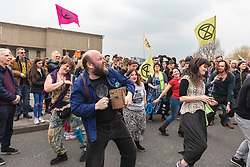 © Licensed to London News Pictures. 16/04/2019. London, UK. A man dances to a wind-up music player as police begin to arrest and remove Extinction Rebellion protesters on Waterloo Bridge. The protesters are demanding urgent action from governments on climate change. Photo credit: Rob Pinney/LNP