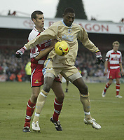 Photo: Aidan Ellis.<br /> Doncaster Rovers v Bristol City. Coca Cola League 1.<br /> 26/11/2005.<br /> Bristol's Baz Savage holds off Doncaster's Nick Fenton