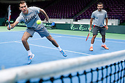 (L) Jerzy Janowicz &amp; (R) Michal Przysiezny both from Poland while training session one day before the BNP Paribas Davis Cup 2014 between Poland and Croatia at Torwar Hall in Warsaw on April 3, 2014.<br /> <br /> Poland, Warsaw, April 3, 2014<br /> <br /> Picture also available in RAW (NEF) or TIFF format on special request.<br /> <br /> For editorial use only. Any commercial or promotional use requires permission.<br /> <br /> Mandatory credit:<br /> Photo by &copy; Adam Nurkiewicz / Mediasport