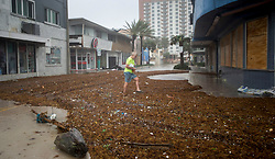 A man walks through accumulated algae on the waterfront of Fort Lauderdale, FL, USA, as Hurricane Irma passes through on Sunday, September 10, 2017. Photo by Paul Chiasson/CP/ABACAPRESS.COM