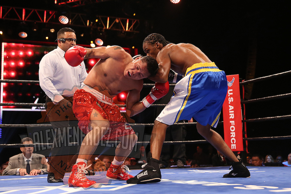WINTER PARK, FL - AUGUST 02: John Jackson (R) fights against Dennis Laurente during the Premier Boxing Champions on Bounce TV boxing match at Full Sail University - Ebbs Auditorium on August 2, 2015 in Winter Park, Florida.  (Photo by Alex Menendez/Getty Images) *** Local Caption *** John Jackson; Dennis Laurente