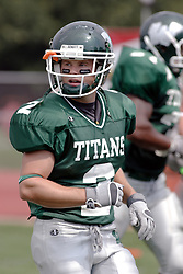 09 September 2006  Titan Chad Olson..In the first ever football competition between the Olivet Comets and the Illinois Wesleyan Titans, the Titans strut off the field with a 21- 6 victory. .Game action took place at Wilder Field on the campus of Illinois Wesleyan University in Bloomington Illinois.