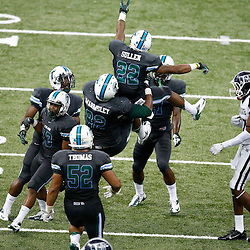 Aug 29, 2013; New Orleans, LA, USA; Tulane Green Wave cornerback Jordan Sullen (22) celebrates after an interception during the second half of a game against the Jackson State Tigers at the Mercedes-Benz Superdome. Tulane defeated Jackson State 34-7. Mandatory Credit: Derick E. Hingle-USA TODAY Sports