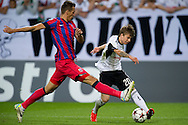 (L) Legia Henrik Ojamaa fights for the ball with (R) Steaua's Iasmin Latovlevici during the UEFA Champions League play-off second leg match between Legia Warsaw and FC Steaua Bucuresti at Pepsi Arena Stadium in Warsaw on August 27, 2013.<br /> <br /> Poland, Warsaw, August 27, 2013<br /> <br /> Picture also available in RAW (NEF) or TIFF format on special request.<br /> <br /> For editorial use only. Any commercial or promotional use requires permission.<br /> <br /> Photo by © Adam Nurkiewicz / Mediasport
