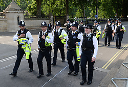 Police in Westminster ahead of the State Opening of Parliament, in the House of Lords at the Palace of Westminster in London.