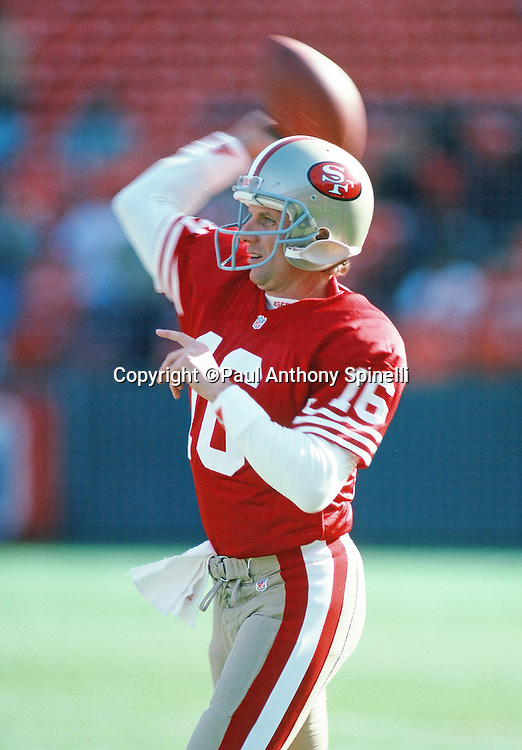 San Francisco 49ers quarterback Joe Montana (16) throws a pregame pass before the NFL football game against the Tampa Bay Buccaneers on Dec. 19, 1992 in San Francisco. The 49ers  won the game 21-14. (©Paul Anthony Spinelli)