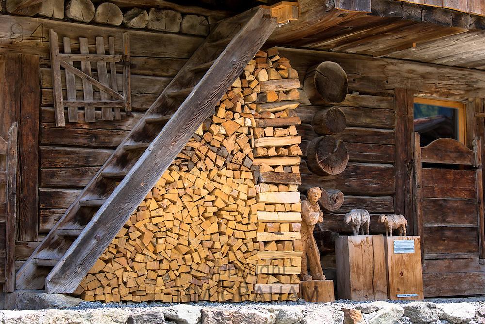 Woodpile of wood carver's studio in Klosters in Graubunden region, Switzerland