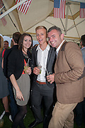 KATHERINE TRICKER; SHAUN WALLIS; AARON RUDD, Charlie Gilkes and Duncan Stirling host Inception Group's Hamptons Garden party on the rooftop garden of the Ballymore marketing suite overlooking the site of the new US embassy. Embassy Gardens, London SW8.  12 July 2012.
