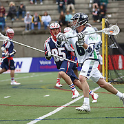 Ben Rubeor #6 of the Chesapeake Bayhawks keeps the ball from Mitch Belisle #85 of the Boston Cannons during the game at Harvard Stadium on April 27, 2014 in Boston, Massachusetts. (Photo by Elan Kawesch)