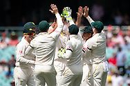 The Australian team celebrate the wicket of Indian player K.L Rahul at the 4th Cricket Test Match between Australia and India at The Sydney Cricket Ground in Sydney, Australia on 03 January 2019.