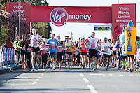 Runners including Michael Owen and Lewis Moody run away from the Green Start at The Virgin Money London Marathon 2014 on Sunday 13 April 2014<br />