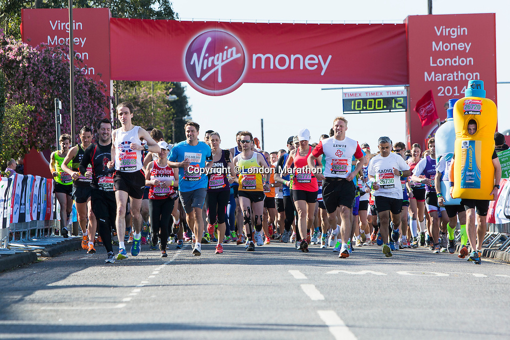 Runners including Michael Owen and Lewis Moody run away from the Green Start at The Virgin Money London Marathon 2014 on Sunday 13 April 2014<br /> Photo: Neil Turner/Virgin Money London Marathon<br /> media@london-marathon.co.uk