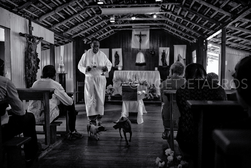Funeral service at Christ the King Church at Lombadina community. This church was constructed, 1932,  with different materials from the area. The walls and ceiling where initially made with paperbark which is now covered with corrugated iron. Western Australia