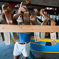 "VENICE, ITALY - SEPTEMBER 04:  A member of the Voga Veneta Lido rowing club chooses a ""forcola"" during preparations  ahead of Sunday Historic Regata on September 4, 2010 in Venice, Italy. The Historic Regata is the most exciting rowing race on the Gran Canal for the locals and one of the most spectacular ***Agreed Fee's Apply To All Image Use***.Marco Secchi /Xianpix. tel +44 (0) 207 1939846. e-mail ms@msecchi.com .www.marcosecchi.com"