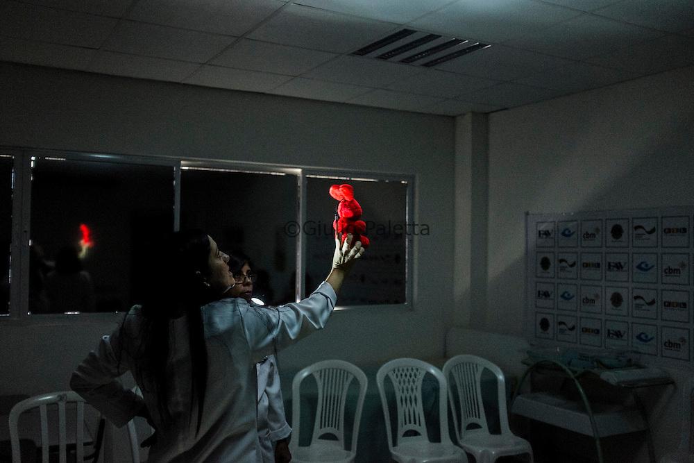 Specialized doctors teach exercises techniques to visually stimulate children with microcephaly at the rehabilitation center FAV (Fundação Atilio Valente) in Recife, Pernambuco