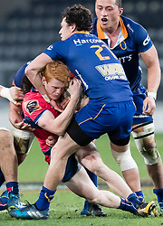 Tasman's Finlay Christie, left, is tackled by Otago's Jonathan Ruru in the Mitre 10 Cup rugby match, Forsyth Barr Stadium, Dunedin, New Zealand, Sept. 16 2017.  Credit:SNPA / Adam Binns ** NO ARCHIVING**