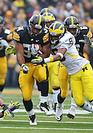 November 05, 2011: Iowa Hawkeyes running back Marcus Coker (34) is hit by Michigan Wolverines cornerback J.T. Floyd (8) during the second quarter of the NCAA football game between the Michigan Wolverines and the Iowa Hawkeyes at Kinnick Stadium in Iowa City, Iowa on Saturday, November 5, 2011. Iowa defeated Michigan 24-16.