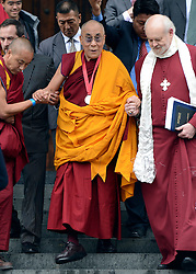 © Licensed to London News Pictures. 14/05/2012. City of London, UK The Dalai Lama (C with medal) and The Bishop of London Richard Chartres leaves St Paul's Cathedral today 14 may 2012 after being presented with the £1.1m Templeton annual prize in his first visit to the Cathedral. The award is for a living person who has 'made an exceptional contribution to affirming the spiritual dimension of life'.. Photo credit : Stephen Simpson/LNP