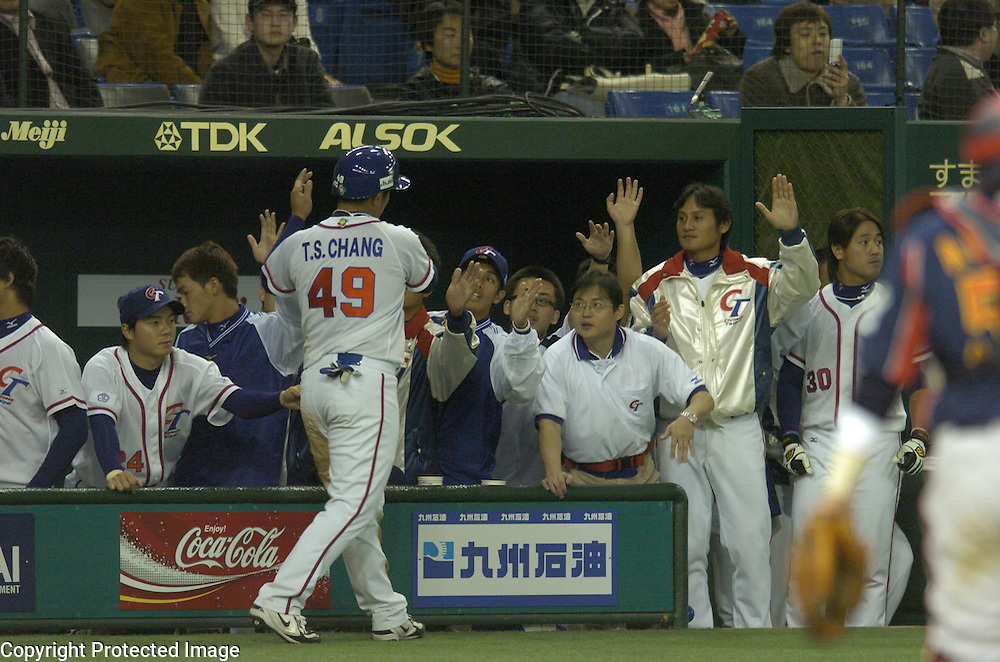 Team Chinese Taipei congratulates #49 Tai-Shan Chang after scoring in the 6th inning against Team Japan in Game 4 of the World Baseball Classic at Tokyo Dome, Tokyo, Japan.